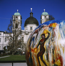 Painted sphere in front of a church, Dreifaltigkeitskirche II, Salzburg, Austria von Panoramic Images
