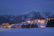 Buildings lit up at dusk, Courchevel, French Alps, France von Panoramic Images