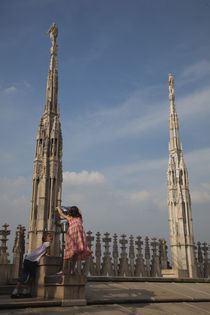 Two girls at an observation point on a cathedral roof by Panoramic Images
