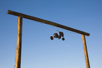 Toy tractor hanging on an entrance by Panoramic Images