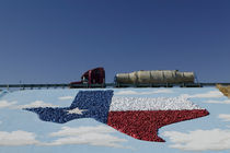 Low angle view of truck and map of Texas on the slope beside a highway by Panoramic Images