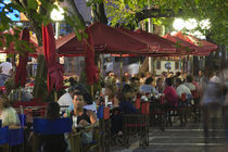 Tourists sitting at a sidewalk cafe, Avenida Sarmiento, Mendoza, Argentina by Panoramic Images