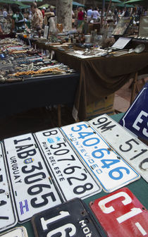 Old license plates in a street market, Plaza Constitucion, Montevideo, Uruguay by Panoramic Images