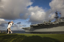 Sculpture Unconditional Surrender with USS Midway aircraft carrier by Panoramic Images