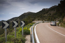 Car on the road, Genna Silana Pass, Gennargentu Mountains, Sardinia, Italy von Panoramic Images