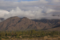 Clouds over mountains by Panoramic Images