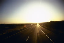 Road passing through a landscape at sunset, Interstate 40, Arizona, USA by Panoramic Images