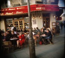Tourists sitting at a sidewalk cafe, Bistrot Ile St Louis, Paris, France by Panoramic Images
