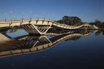 Bridge across a river by Panoramic Images