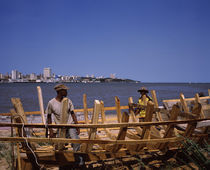 Two men making a boat at the coast, Delagoa Bay, Maputo, Mozambique by Panoramic Images