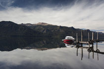 Motorboat in the lake by Panoramic Images