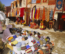 Woman selling knit hats in a market, Marrakesh, Morocco by Panoramic Images