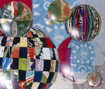 Floating globes filled with reflections of multiple fabric patterns von Panoramic Images