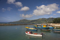 Boats with a pier in the background, Bel Ombre, Mahe Island, Seychelles by Panoramic Images