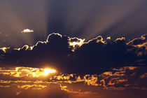 Sun rising behind dark clouds, Montana, USA. by Panoramic Images