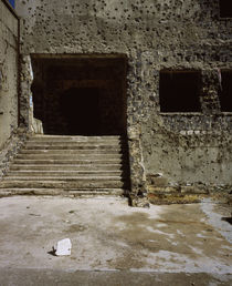 Wall and the doorway of a building with bullet holes, Syria by Panoramic Images