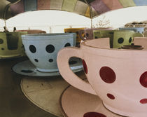 Tea cup ride in an amusement park von Panoramic Images