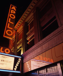 Low angle view of a theatre lit up at night von Panoramic Images