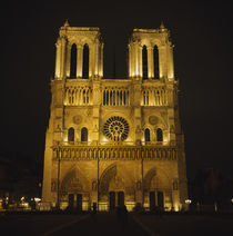 Facade of a cathedral lit up at night, Notre Dame De Paris, Paris, France by Panoramic Images