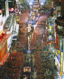 High angle view of crowd on the street celebrating New Year's Eve by Panoramic Images
