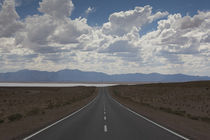 Road leading towards a salt flat by Panoramic Images