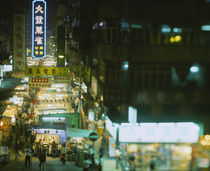 High angle view of a market lit up at night by Panoramic Images