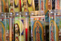 Close-up of Jesus Christ and Virgin Mary on candle holders by Panoramic Images