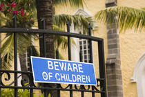 Beware of Children sign on a gate by Panoramic Images