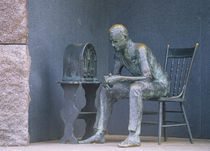 Bronze statue of a man listening to radio during great depression by Panoramic Images