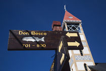 Low angle view of street signs with a church von Panoramic Images