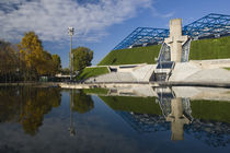 Reflection of a stadium in a pond by Panoramic Images
