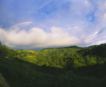 Clouds and rainbow over a mountain, Costa Rica by Panoramic Images