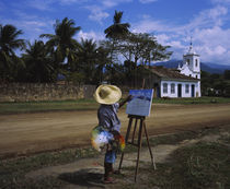 Man painting a church on the roadside by Panoramic Images