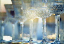 Close-up of wine glasses in a row, Berlin, Germany von Panoramic Images