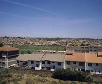 Houses with shanty town in the background, Kibera, Nairobi, Kenya by Panoramic Images