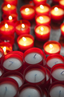 Votive candles in a cathedral von Panoramic Images
