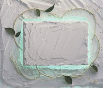 Light grey plaster frame with leaves and aqua tint around center by Panoramic Images