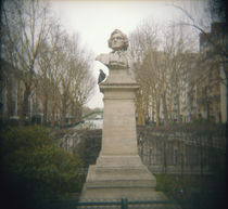 Pigeon beside a bust in a park, France by Panoramic Images