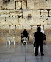 Three men praying in front of a wall, Western Wall, Old City, Jerusalem, Israel by Panoramic Images