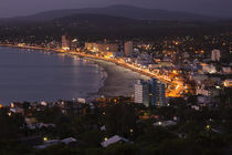 Buildings lit up at dusk, Piriapolis, Maldonado, Uruguay by Panoramic Images
