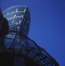 Low angle view of a glass building by Panoramic Images