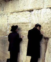 Two men praying in front of a wall, Western Wall, Old City, Jerusalem, Israel von Panoramic Images