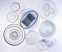 Arrangement of clear glass cups, plates, bowls and glasses with dark blue ribbon von Panoramic Images