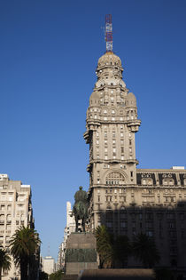 Buildings in a city, Salvo Palace, Plaza Independencia, Montevideo, Uruguay by Panoramic Images