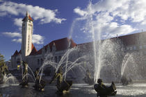 Fountains in front of a railroad station by Panoramic Images