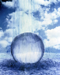Water raining down on crystal sphere in churning water with clouds by Panoramic Images