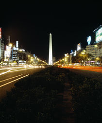 Obelisk lit up at night in a city von Panoramic Images