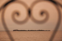 Small island viewed through heart shaped pattern von Panoramic Images