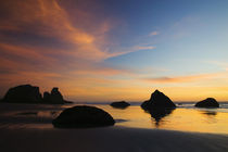 Sunset sky silhouetted sea stacks on Bandon Beach Bandon Beach State Park by Panoramic Images