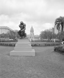 Statue of the thinker in a formal garden by Panoramic Images